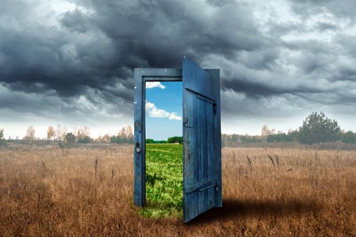 old door in the middle of a dry field opening to a blue sky, hypnosis Vancouver BC